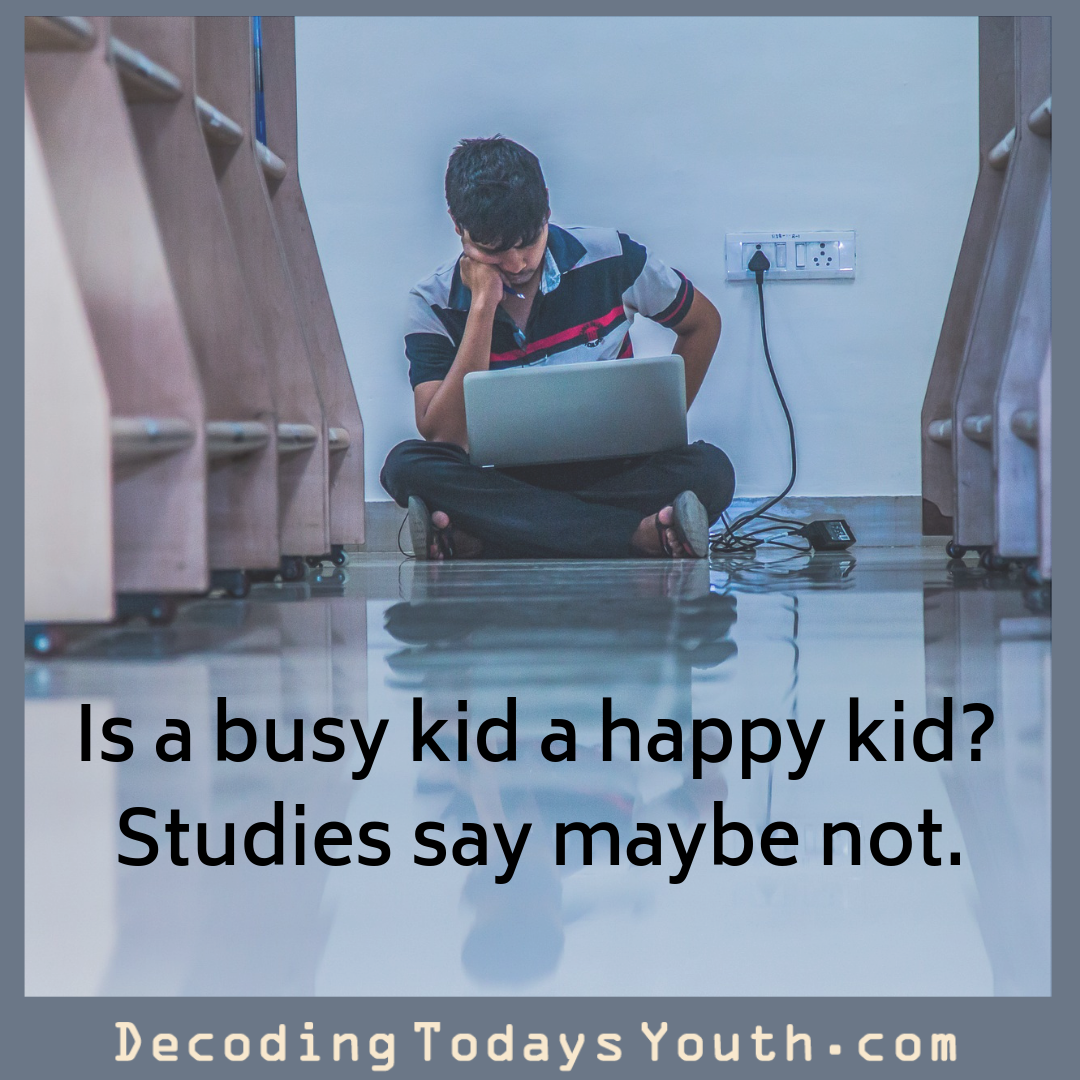 Is a busy kid a happy kid? Studies say maybe not.